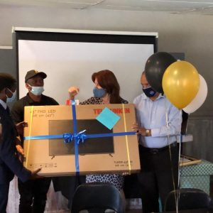The CPF hands Colonel Ledwaba his gift of a television screen with a surge protector plug